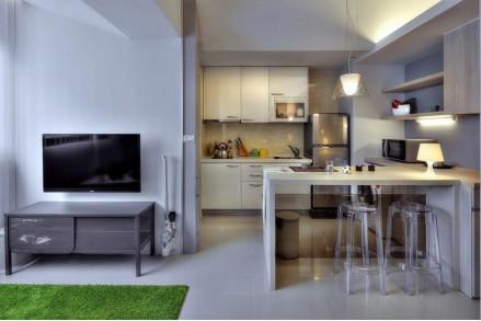 Прямая встроенная кухня в студии